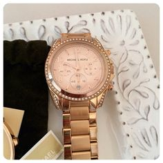 """FLASH SALE  Michael Kors Rose Gold Watch Michael Kors rose gold chronograph style bracelet watch with faux diamonds. Big, bold bling! Needs battery. 1 1/2"""" face, worn only a few times and stored carefully. Extra links supplied. Needs battery due to lack of use. Image shows some wear on the plating on the back of the bracelet -- this is common with plated watches however authorized retailers can have it replated. Priced accordingly. No trades holds or PayPal  Price is firm  FINAL PRICE…"""