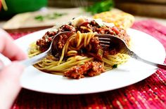 Spaghetti Sauce by Ree Drummond / The Pioneer Woman...love that she adds a wedge of cheese...melted goodness...:)