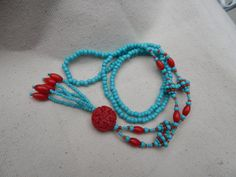 Red and Turquoise beaded necklace with by TheVelvetMannequin