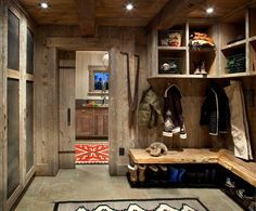 The mudroom is home to a great deal of activity, particularly when it comes to dealing with ski or hiking gear. It's also the home's main storage space for cleaning supplies, laundry and the family's dogs.