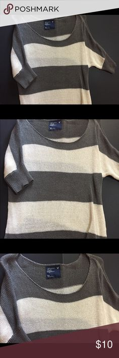 3/4 Sleeve American Eagle Sweater 3/4 Sleeve Crocheted Sweater by American Eagle. Grey and white striped, size small. Slightly pulled on the shoulders from hangers. Bundle and get 2 $5 items for only $6! American Eagle Outfitters Sweaters Crew & Scoop Necks