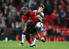 Manchester United's Romelu Lukaku and Tottenham Hotspur's Ben Davies battle for the ball during the Premier League match at Old Trafford Manchester Ben Davies, Premier League Matches, Old Trafford, Tottenham Hotspur, Manchester United, Battle, The Unit, Man United