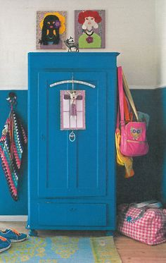 Love the collage paintings on top of the wardrobe! Children's room - old wardrobe painted electric blue.