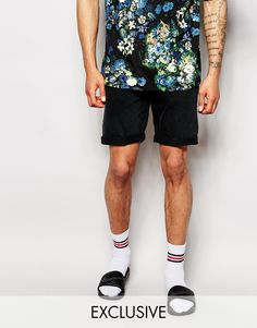 """Denim shorts by Reclaimed Vintage Non-stretch denim Button fly Five pocket styling Turn-up hem Straight fit - cut with a straight leg Machine wash 100% Cotton Our model wears a 32""""/81cm regular and is 188cm/6'2"""" tall"""
