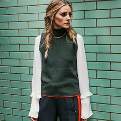 Olivia pairs a a Rebecca Minkoff bell-sleeved blouse with two Zara pieces for the perfect look.
