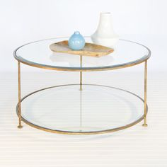 "worlds away Rollo Round Gold Coffee Table 18"" h x 37"" diameter  Round gold leaf 2-tier coffee table with beveled glass tops.  stock #: ROLLO G"