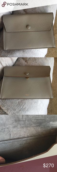 """Authentic  Celine pebbled Pouch never used . Authentic Never Used Celine Pebble grain leather clutch -with snap closure and suede interior  & gold Celine logo . The color is Dune . Measurements 8"""" length by 6"""" x . 5 . Never worn , mint condition perfect for a night out or to put inside a handbag . No Trades - offer only thru offer button please ! Celine Bags Clutches & Wristlets"""