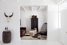 Bamileke wood stools (Cameroon), painted white. Lounge area, Maison (Wine) Estate, Franschhoek, South Africa.