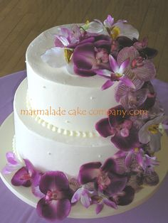 """Orchid Cascade In Purples - Simple 2 tier cake (9"""" and 12"""", 6"""" tall tiers) with cascade of artificial orchids. The groom chose this cake design. I was happy to do it, but suggested fake flowers to save them a ton of $$$!"""