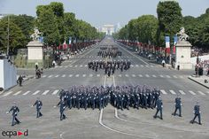 Officers and Cadets of the French Army Combined Arms Military School (École militaire interarmes) marching down Champs-Élysées Avenue in Paris at the 2013 Bastille Day Parade.
