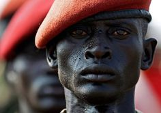 Sudan Peoples Liberation Army soldier stands at attention on the eve of South Sudans independence from Sudan