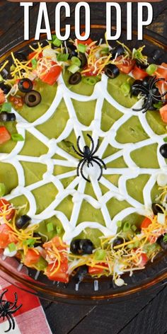 Easy Spooky Halloween 7 Layer Taco Dip recipe is the perfect holiday appetizer. Add the spooky spider web for the holiday, or keep it smooth for year round enjoyment! #halloween #partyfood #spooky