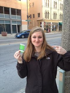 """An excited fan shows off her new Hupy and Abraham Car Accident Card at the Tracy Morgan """"Excuse My French"""" show at the Pabst Theater in Milwaukee, Wisconsin."""