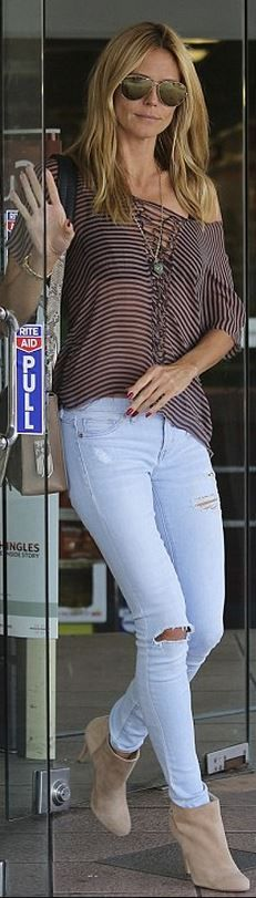 Who made Heidi Klum's purple stripe top, tan suede ankle boots, and blue ripped…
