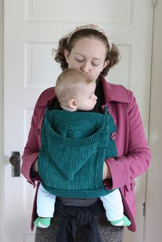 This is a modified version of leethal's skoodlet, to use when I'm carrying my baby in our Sleepywrap sling. It has a hood for him, and instead of the scarflet sections, it has a long back panel that buttons onto my coat on either side. This way, I'm able to button my coat around him, and we both stay warm! I also added a pocket so I'd be able to keep my hands cozy.