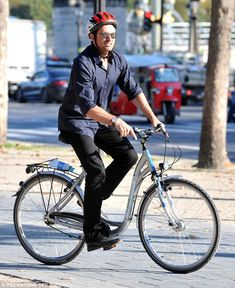 Paris by bike: Hugh Jackman took to two wheels to explore the sights of the French capital