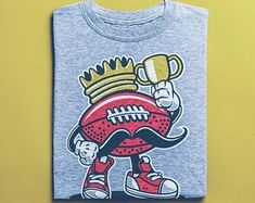 Items similar to Football King Skater Shirt- Graffiti Shirts - Comic Illustration- Skateboard T-Shirt, Street Art Apparel, Unisex Clothing on Etsy Skater Shirts, T Shirts, Good Birthday Presents, Surf Shirt, Graffiti, African Safari, Street Art, Vintage Shirts, Tshirts Online