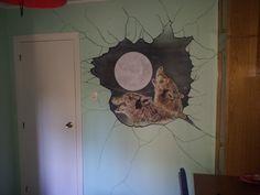 Mural pintado Lobos en pared rota