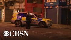LONDON — A man armed with a knife and wearing a fake explosive device strapped to his body was shot and killed by the police in South London on Sunday after he was suspected of stabbing people on Sunday. South London, Cbs News, Police, Sunday, People, Domingo, People Illustration, Law Enforcement, Folk