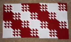 Interesting red and white quilt design.