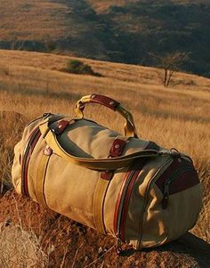 Rufiji Safari Luggage: A deluxe and spacious travel bag using made of canvas and leather for extra strength. Soft,strong and stylish - made for your safari!