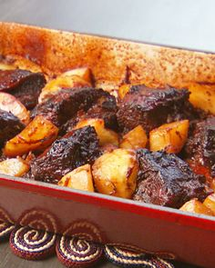 "Luscious Oven-Braised Short Ribs--Short ribs get a lot of their flavor from their fat; as the meat cooks, the fat melts away and infuses the sauce, making it rich, smooth, and absolutely delicious.From the book ""Mad Hungry,"" by Lucinda Scala Quinn"