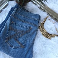 7 for all Mankind boot cut jeans Classic pair of 7 for all Mankind boot cut jeans with signature 7 pockets 7 for all Mankind Jeans Boot Cut