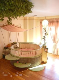 this is the sweetest crib I've ever seen. and in my mind, the railing slides down and it could be a seating/ reading area for a bigger child or adults
