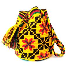 With the same bohemian feel as their big sisters, these one-of-a-kind mini bags are handmade by women artisans of the Wayuu tribe from the desert of La Guajira in northern Colombia. Their ancestral co