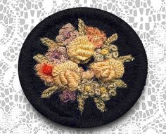 19th century needlework on wool button.