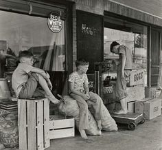 Hanging out on a Saturday afternoon in Tomball, Texas.  1945.