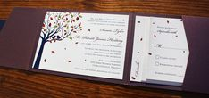 this is the one i love but it doesn't fit into a destination wedding... :(  Purple Love Birds in a Navy Fall Tree Horizontal Pocketfold Wedding Invitations