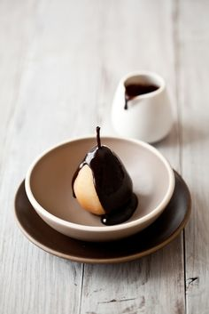Poached pears with warm chocolate sauce.