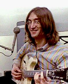 John Lennon playing his Revolution Epiphone guitar being funny.