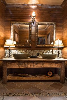 IMAGINE THIS TYPE VANITY WITH SQUARE LESS RUSTIC SINKS AND A WHITE SUBWAY TILE BACKSPLASH AND DECORATIVE MIRRORS AND IN OUR BATH SAME BUT GO A LITTLE DARKER THEME MASTER STAYS LIGHTER DUE TO WHITE TUB ETC. AND MORE MILLWORK FOR LINENS ETC.