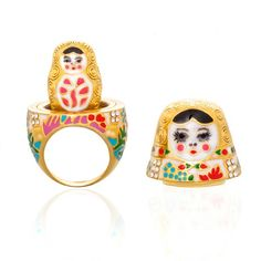 Babushka ring inspired by the Matryoshka Russian doll. And yes it actually opens up and there is a smaller doll inside. Ring measures 1 inch wide by 1 inch long, 1 3/4 inches in height. $225.00