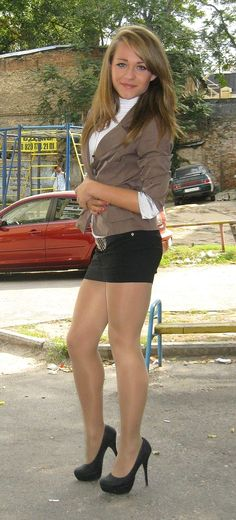 High heels, sheer pantyhose and short skirt for this sexy girl.Woman in pantyhose