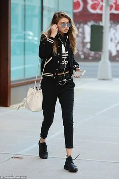 Gigi Hadid wearing Saint Laurent Teddy Bomber Jacket, Tom Ford Leather Small Tassel Bucket Bag, Gentle Monster Love Punch 02 Sunglasses and Adidas Cropped Hoodie
