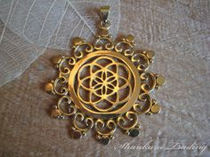 Hey, I found this really awesome Etsy listing at https://www.etsy.com/listing/203898200/sacred-geometry-flower-of-life-brass