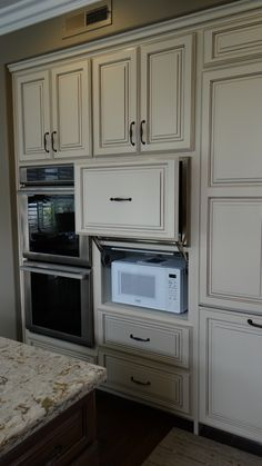 Traditional Cabinets With Pull Up Feature #cabinet #kitchenremodel  #whitekitchen