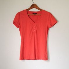 ☀️$13 w/ Make Offer☀️Orange Henley Tee Shirt Top ➻ Great condition.  ➻ Orange. ➻ V-neck. ➻ Henley design. ➻ Short sleeves.  ➻ No trades. Please refrain from asking. ➻ Negotiations will take place through the 'Offer' button ONLY. Style & Co Tops Tees - Short Sleeve