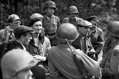 Soldiers of the 110th Infantry Regiment, 28th Division, brief members of the French Resistance on the current battlefield situation around Bonneville, France on August 23, 1944.