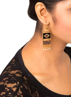 Blend tradition with sophisticated chic with this pair of handmade ESA earrings with gold dipped finish. The hook earrings feature an ikat inspired design made from red and black enamel inlay over a rectangular brass piece. The shape of the earrings and the contemporary design lend it a classy appeal.
