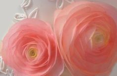 Wafer paper is the hottest trend in the cake industry right now. It is such a versatile medium and is pretty easy to use. Wafer paper makes beautiful flowers. They are super thin and they don't hav...