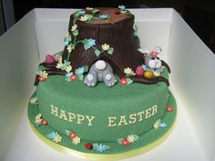 "easter cake for school fete - 9"" vanilla cake with jam and vanilla b/c filling and chocolate cake tree stump with chocolate b/c filling, covered in fondant with gumpaste accents.  Got lots of ideas from other cc cakes, thanks for looking x"
