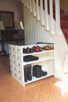 hidden shoe storage under stairs..necessary!