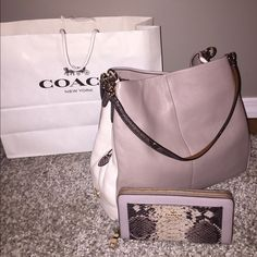 Authentic Coach Bag❤️ ⭐️NWT Coach Bag .. ⭐️ Two sections on each side in the middle there's a zippered section Very roomy This bag is so beautiful  Don't miss out on this one ..⭐️ Matching wallet sold in seperate listing All reasonable offers considered through the offer button  Coach Bags Satchels