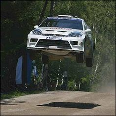 Markko Martin takes to the air in his Ford Focus as he takes the lead during the third day of the Rally of Finland