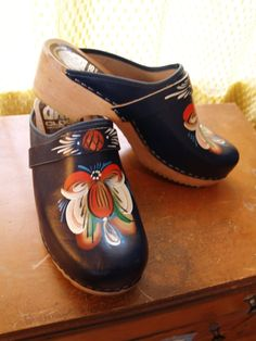 Hand painted clogs~   Bought a brown/yellow/green pair for Saylor! Fun.