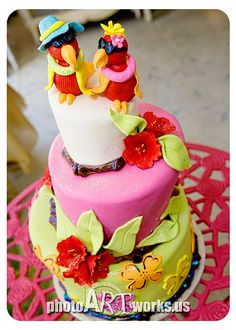 A bridal shower cake for a couple with the last name of Parrot!